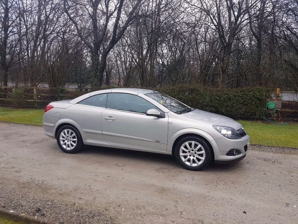 astra twintop manual roof open