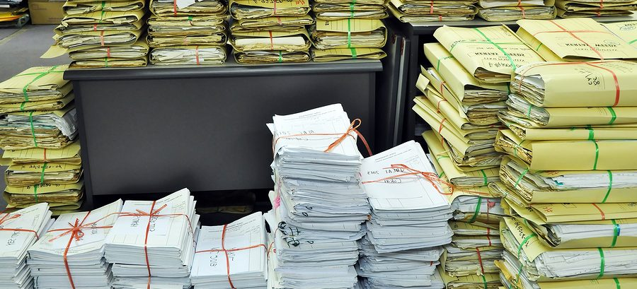 disadvantages of manual filing system used to store payroll records